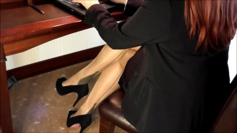 Lady Darla typing in Cuban Heels