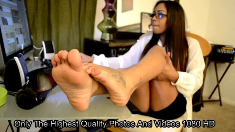 Hot Little Latina Shows Her Tattooed Feet Off While Relaxing At Her Computer