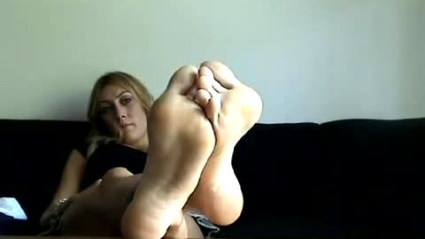 Older Blonde Gal Shows Off Her Bare Feet While Answering Some Questions