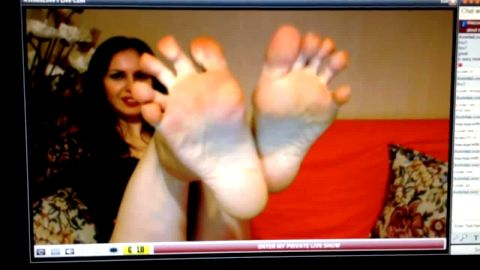 Sexy Woman Takes Off Her Nylons And Massages Her Feet For The Camera