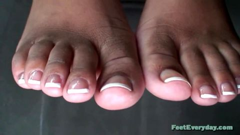 Ebony toes with white French Manicured tips