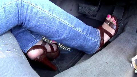 Pretty feet in strappy sandals pumping pedals in old Oldsmobile