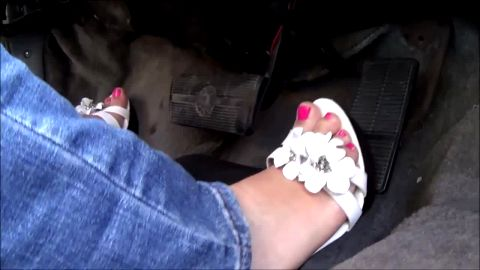Girl With Sexy Jeans and Cute Heels Works Those Pedals Hard As She Drives
