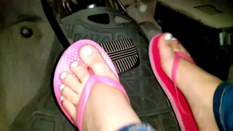 These Cute Feet With Pink Sandals and White Nail Polish Push That Pedal Up and Down Again and Again