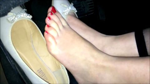 Pedal Pumping Babe with Classy White Dress Shoes Showing off Pretty Red Nails