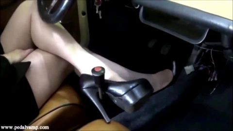 Woman Wearing Black Heals and Nylons Pumps That Pedal Over and Over