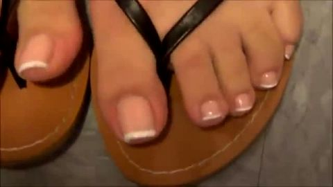 Unbelievably Cute Toes With French Pedicure Dangled Around In Classy Sandals