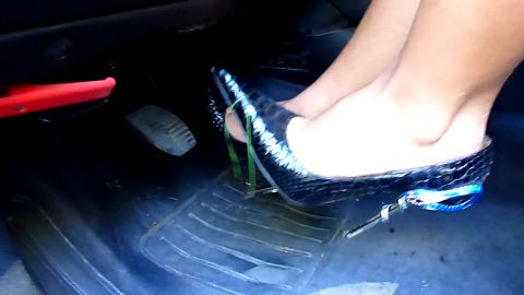 Hot Woman In Blue Gator High Heels Pushes Down Her Car's Gas Pedals