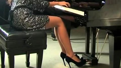 Sexy Slender Chick Wearing Black Heels Plays The Piano