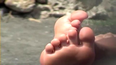 Watch These Beautiful Soft Feet Get Dangled Around On The Beach