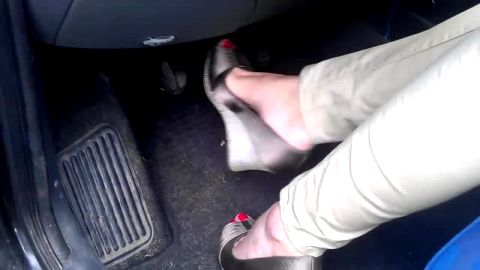 Sexy Woman With Red Toenails In Sandals Plays Around With Her Gas Pedals