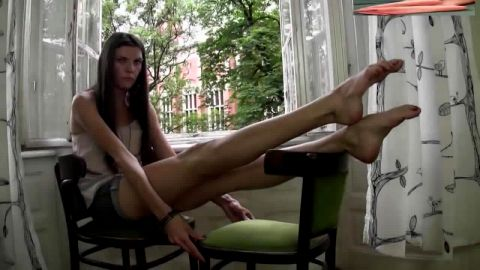 Sexy Young Brunette Girl Relaxes By Her Window And Shows You Her Cute Bare Feet