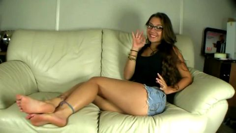 Sexy Little Minx In Short Shorts Chills On The Couch and Shows Off Her Sexy Bare Feet