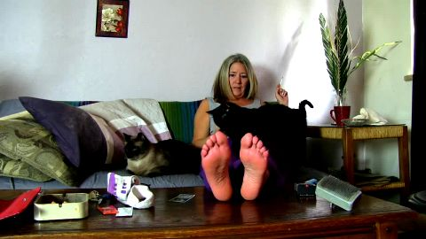 Mature Blonde Woman Relaxes On The Couch While Showing Off Her Bare Feet
