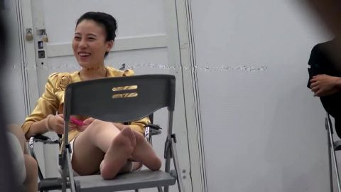 Cute Asian Girl Wearing Stockings Gets Her Feet Spied On While Talking On The Phone