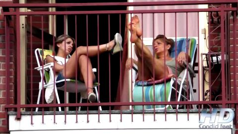 Foot spy enjoys making a video of matures enjoying their balcony.