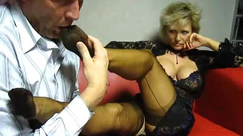 Lady B lets him lick her stockinged toes
