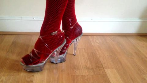 Red fishnets in clear platforms