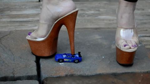 Crushing toy car with tall heel