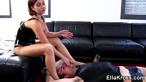 Ella Kross eats a banana while shoving feet in man's mouth