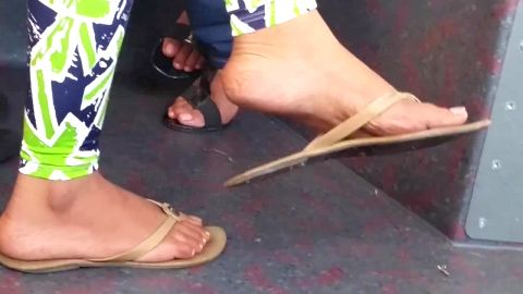Feet in sandals on bus