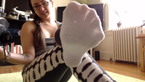 Latina takes off sneakers and cotton socks