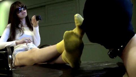 Korean girl's feet serviced by masked man
