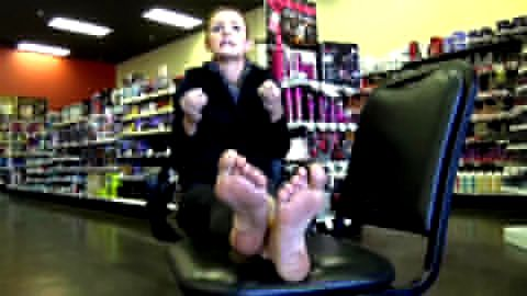 Rubbing soft feet in shoe store
