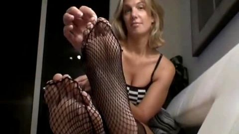 Sexy black fishnet stockinged Blondie