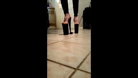 Tall heels obliterating a small toy