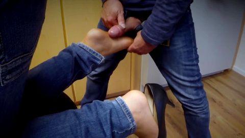 She dangles kitten heel while he rubs cock on sole