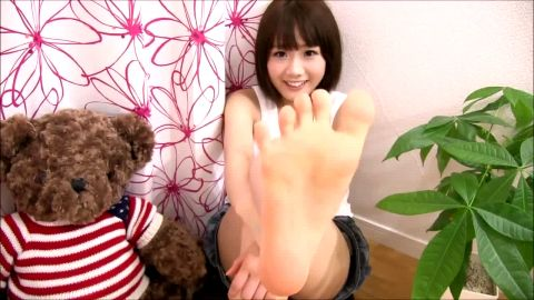 Adorable Japanese teen tickles bare feet with teddy bear