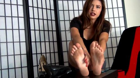 Beautiful brunette in sexy skirt touching her amazing feet in hot JOI vide