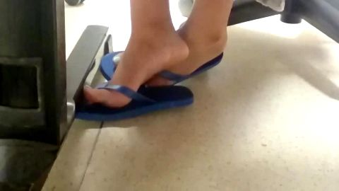 Sexy voyeur feet in blue flip flops getting naughty at the office
