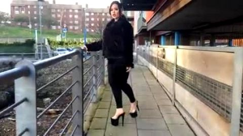 Black heels on thick model outdoors