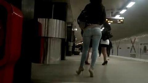 High heeled woman in train station has amazing ass