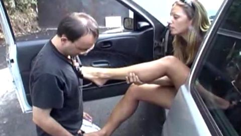 Hot French woman gets foot slave love outside of car