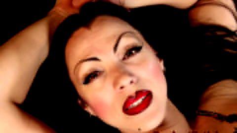 Elvira lookalike teases with her feet