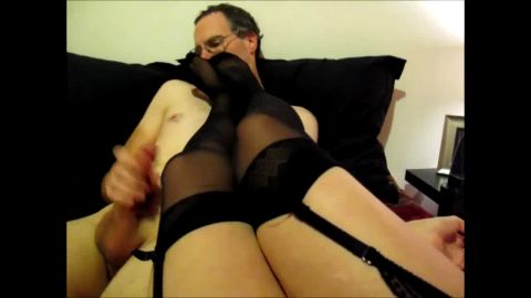 Stocking covered escort shoves feet into jerking dork's face