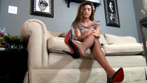 Sexy Louboutins kicked off on couch