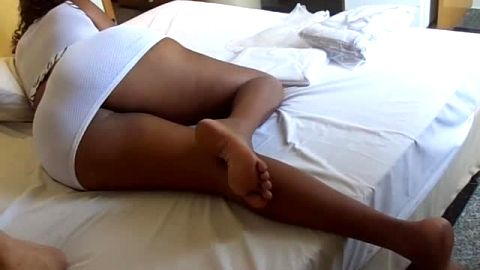 Sexy ebony with an amazing ass is on her side exposing her lovely black feet