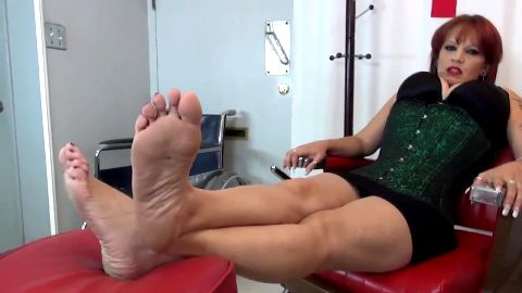 Mistress Biance in doctor's office enjoys footplay