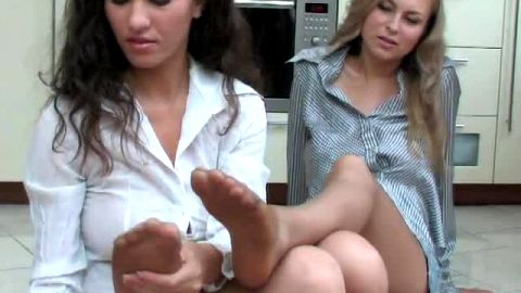 Lesbians try on shoe collection and suck nylon covered toes