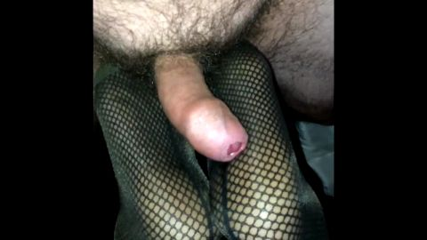Uncut amateur cock rubbing on fishnet covered feet