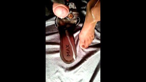 Black gloved handjob and cumming onto shoe sole