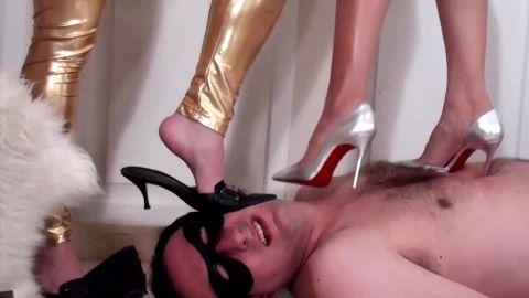 Feet crushing - Two women standing on man in heels