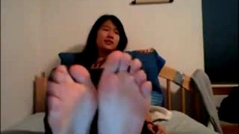 Bubbly Asian college girl wiggles toes