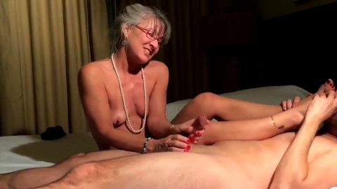 Bitchy granny gives handjob and finishes with footjob