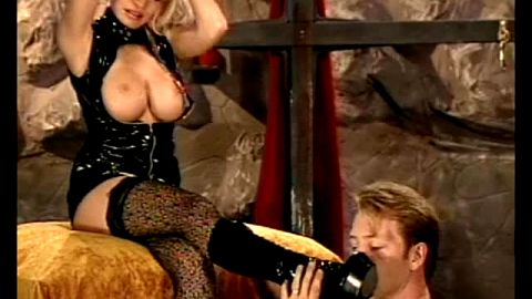80's rock chick rubs boots with her pussy juice