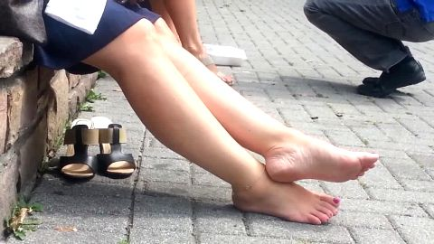 Cute girl showing off her gorgeous amateur feet while resting in public